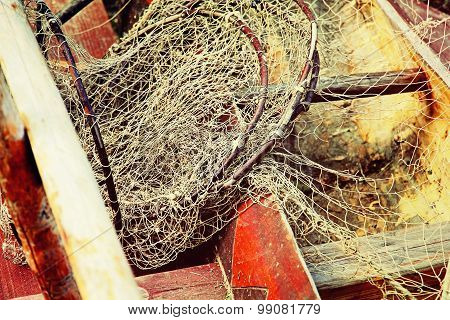 Fishing Tackles In Old Wooden Boat Taken Closeup.