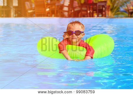 little boy in life fun at swimming pool