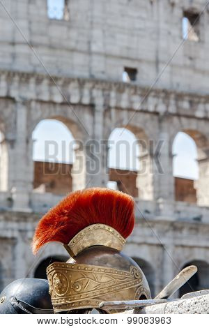 Roman helmet in front of Colosseum