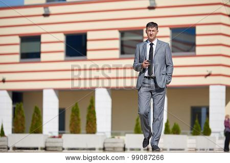 urban outdoor portrait of middle aged senior  business man