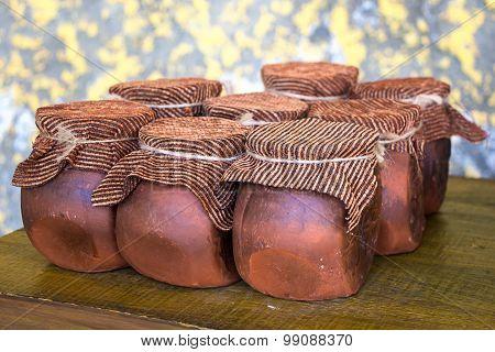 Photo of clay brown honey pots