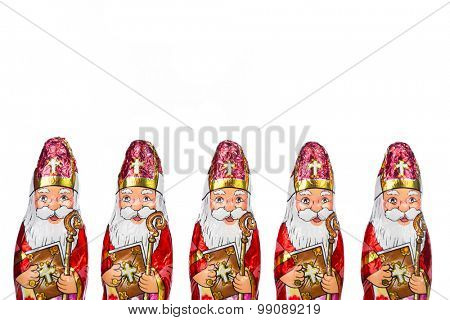 Close up of Sinterklaas. Saint  Nicholas chocolate figures of  Dutch character of Santa Claus.Isolated on white background.