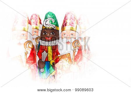 Close up of Zwarte Piet. Black Pete chocolate figure of  Dutch character of Santa Claus. Isolated on white background.