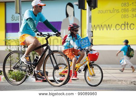 Bangkok Thailand : August16 : Thai Man And Children  Riding Bicycle  In