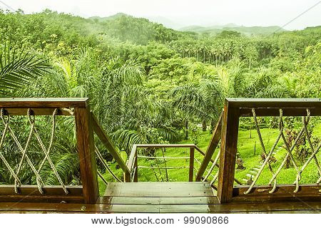 view of mountain with fog in raining season,form Butigue Camp balcony at Surat Thani, Thailand