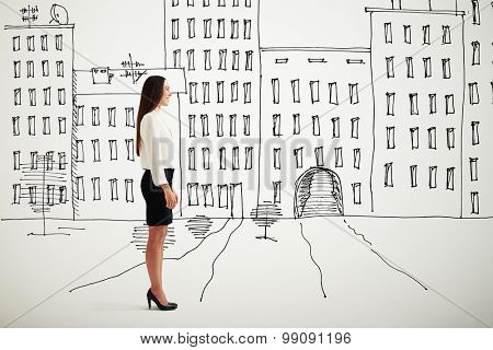 sideview of smiley woman in formal wear over drawing cityscape