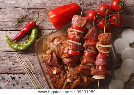Raw Kebab In A Spicy Marinade On Skewers. Horizontal Top View