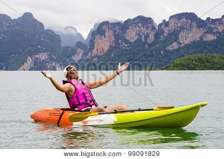 Young Asia man paddling