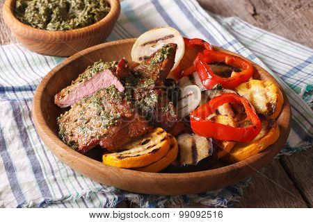 Beefsteak And Grilled Vegetables With Pesto Close Up On A Plate. Horizontal