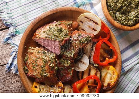 Veal Meat And Grilled Vegetables With Pesto Closeup. Horizontal Top View