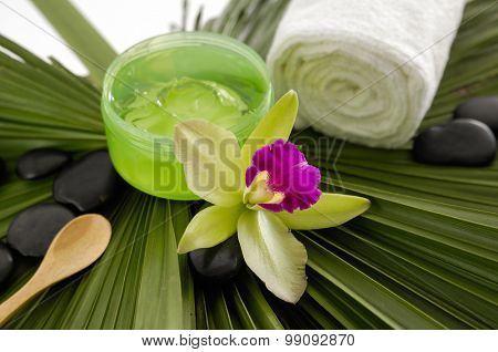 Spa set with towel,orchid on palm texture
