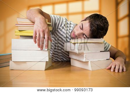 Student asleep in the library against room with large window showing city
