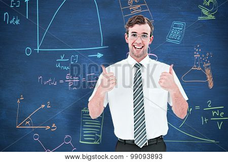 Happy geeky businessman with thumbs up against blue chalkboard