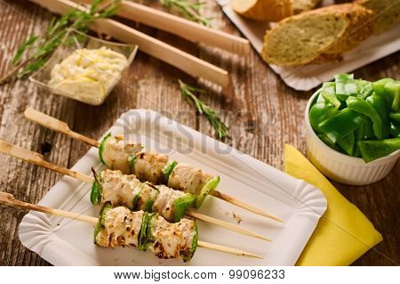 Grilled Chicken And Peppers On A Skewer In Picnic Setting