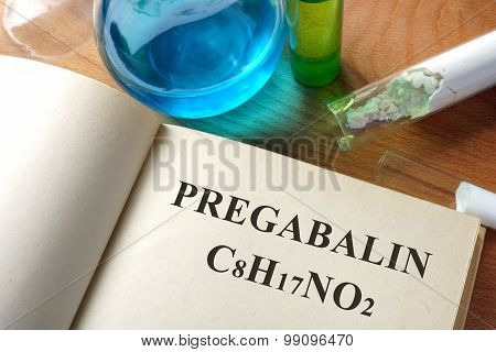 Paper with Pregabalin and test tubes.