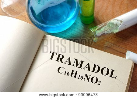 Paper with tramadol and test tubes.