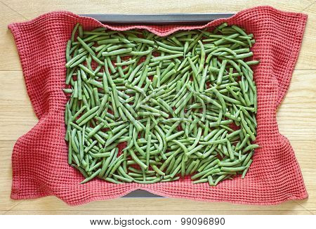Green beans in metallic baking dish