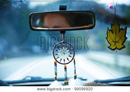 Image of windshield on the road, way and highway. with dream catcher