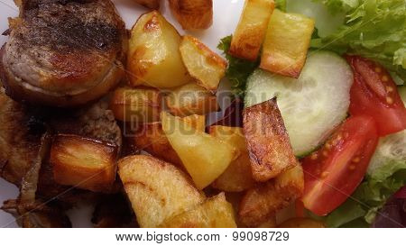 Pork meat with roast potatoes and vegetable