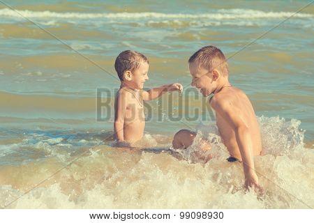 Happy  Children - Two Boys Having Fun On The Beach