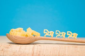 foto of hackney  - Pasta in the form of animals and a wooden spoon on a blue background - JPG
