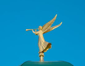 image of angel-trumpet  - Golden angel with a trumpet on a background of blue sky - JPG