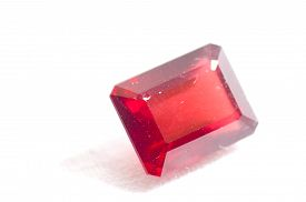foto of dodecahedron  - ruby red garnet jewel crystal on a white background - JPG