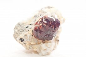 image of dodecahedron  - a large spessartine garnet embeded in quartz and granite - JPG