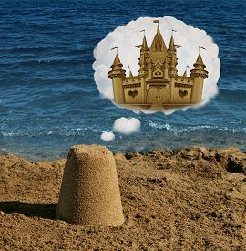 image of future  - Think big concept and positive visualization symbol as an ordinary basic sand shape dreaming and imagining greatness as a majestic castle as a metaphor to imagine future potential and success focus in business and life - JPG