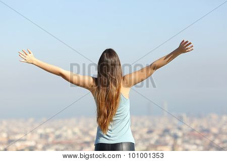 Happy Tourist Woman Raising Arms Looking At The City