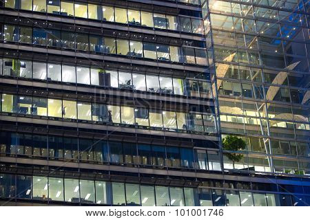 LONDON, UK - 7 SEPTEMBER, 2015: Canary Wharf office's windows lit up in the night.