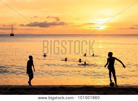 Childrens Silhouette Playing Soccer On Sunset At Tarrafal Beach In Santiago Island In Cape Verde - C