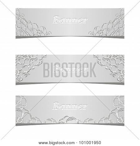 Three banners with black and white flowers