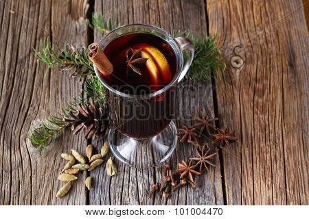 Mulled Wine And Spices On Rustic Wooden Table