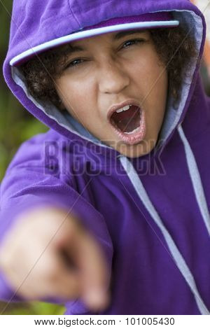 Young African American girl female child wearing hoody hoodie & baseball cap shouting and pointing to camera