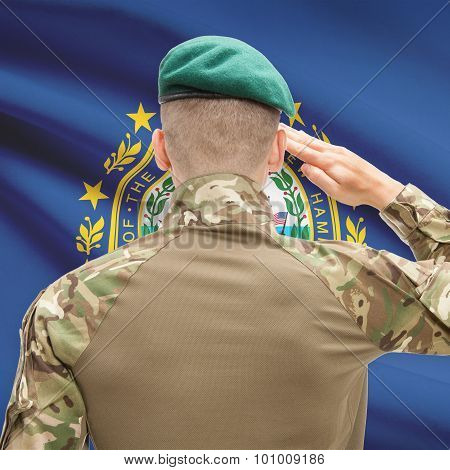 Soldier Saluting To Usa State Flag Conceptual Series - New Hampshire