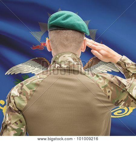 Soldier Saluting To Usa State Flag Conceptual Series - North Dakota