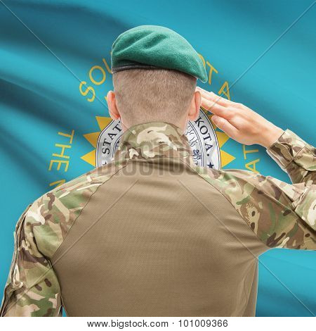 Soldier Saluting To Usa State Flag Conceptual Series - South Dakota