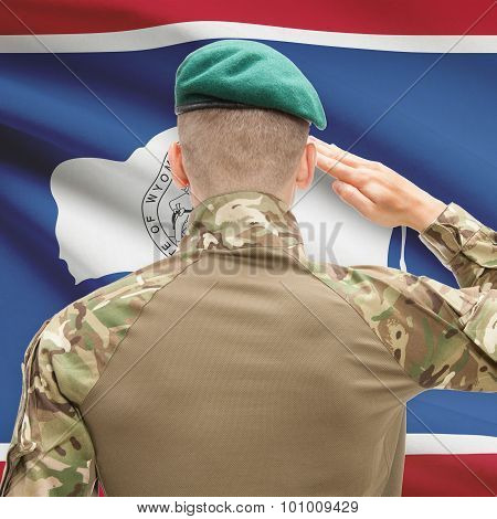 Soldier Saluting To Usa State Flag Conceptual Series - Wyoming