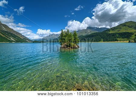 Amazing sunny day at Silsersee lake in the Swiss Alps. Segl, Switzerland, Europe.