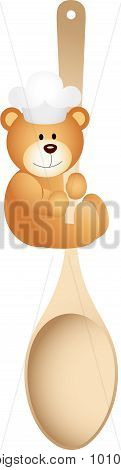 Teddy bear holding wooden spoon