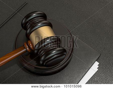 Wooden Judges Gavel And Leather Folder On Black Leather Desk