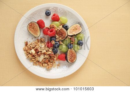 Fresh summer fruits with granola
