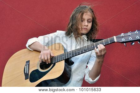 Teenager Playing Guitar In The Street