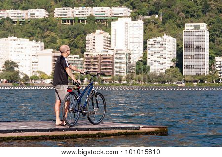 Man with bicycle on the pier