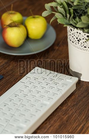 Keyboard On The Wooden Desk