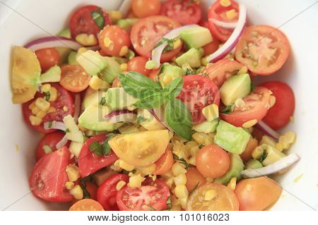 Corn, avocado, tomato and basil salad