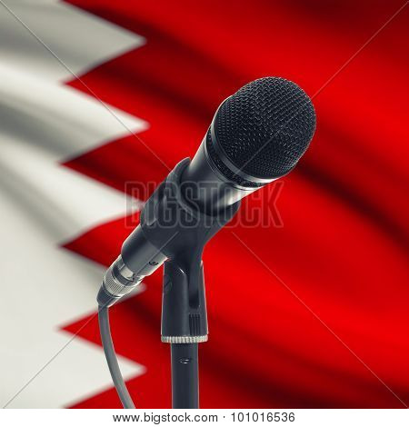 Microphone On Stand With National Flag On Background - Bahrain