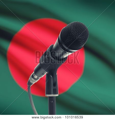 Microphone On Stand With National Flag On Background - Bangladesh
