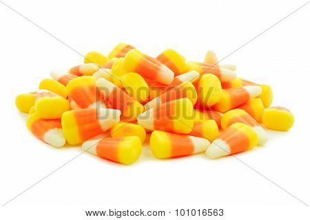 Pile of Halloween candy corn over white